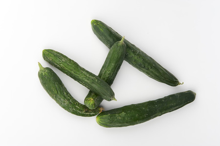 ailment: some biological cucumbers on white background Stock Photo