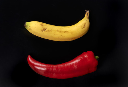 ailment: a pepper and a banana on a black background