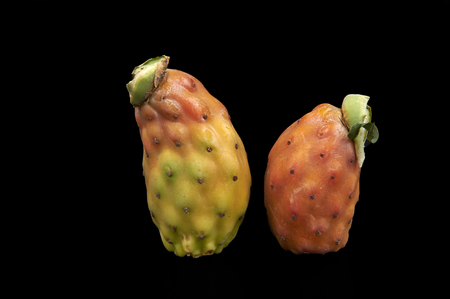 ailment: some biological prickly pears on a black background