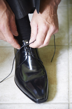 shoelaces: a man tying his shoelaces Stock Photo