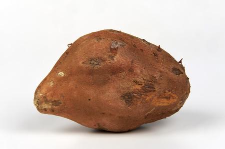 ailment: a sweet potato ( ipomoea batatas )  on white background Stock Photo