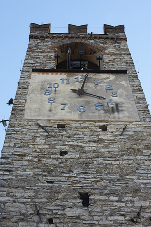 Rovato (Bs), Italy,  the tower bell of the church of  Santa Maria Assunta of the sixteenth century Foto de archivo - 113564862
