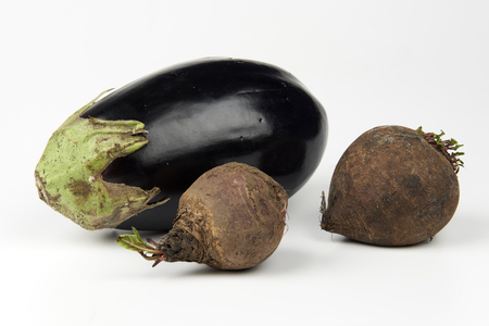 ailment: some organic beetroots and an eggplant on white background