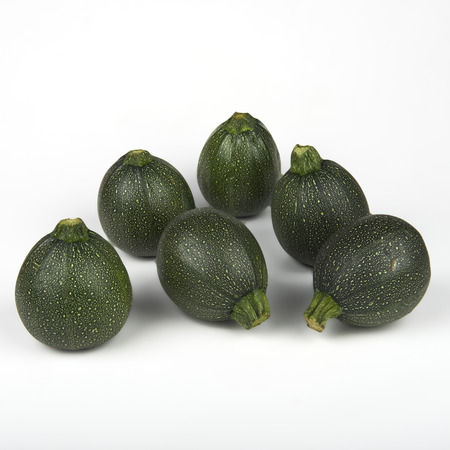 ailment: some organic zucchini on white background Stock Photo