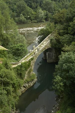 confluence: Clanezzo (Bg), Italy, the romanesque bridge of Attone, of the tenth century,   on the  Imagna river  at the confluence of the river Brembo