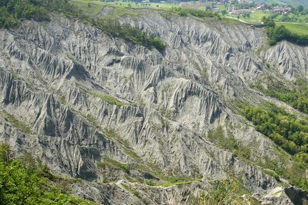 Canossa (Re),Italy, the gullies near the cliff of the castle of Matilde of Canossa Foto de archivo - 101435552