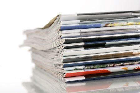 closeup pile of magazines