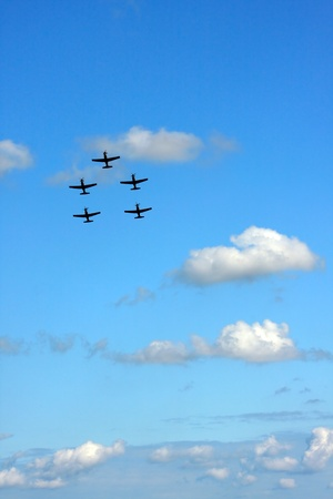 airshow: five airplanes in formation on airshow