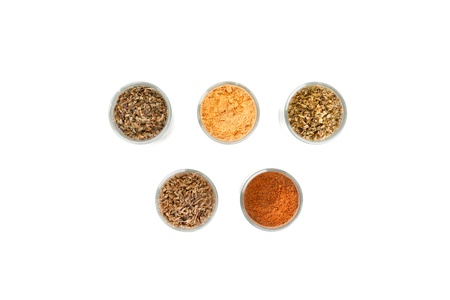 Spices and herbs in small glass bowls