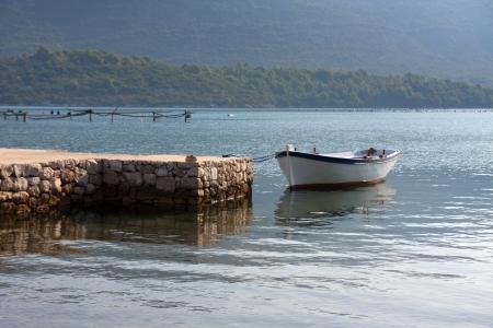 Wooden fishing boat moored along the coast of Croatia