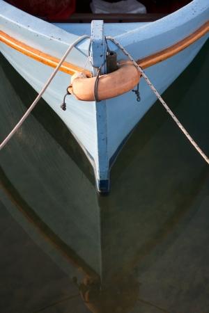 closeup of wooden boat in Adriatic sea Standard-Bild