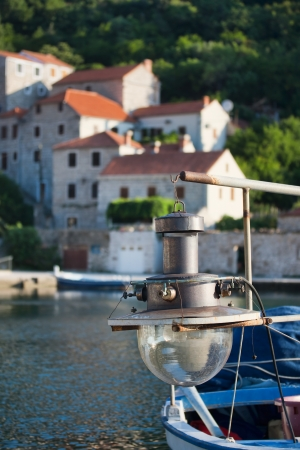 Lamp for fishing on wooden boat, Adriatic coast photo
