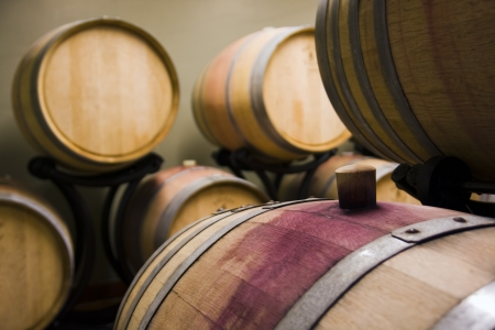 cap and the wine barrel in cellar Stock Photo