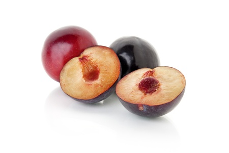 cut plums isolated on white background