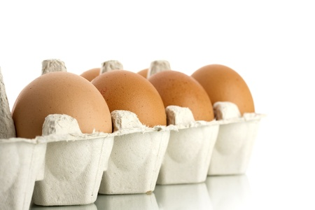 aliments: egg packaging isolated on white background