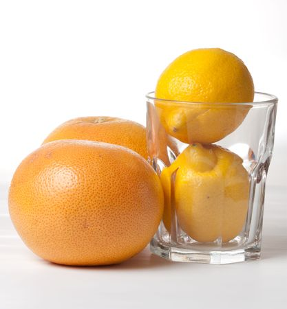 Oranges with lemons in glass Stock Photo