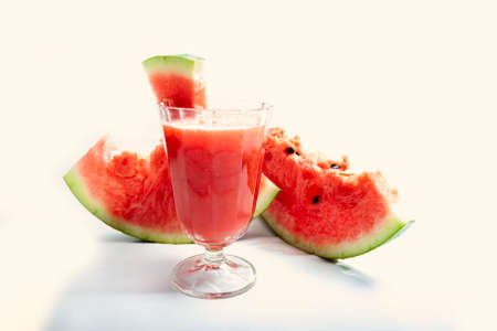 refreshing cold watermelon juice on a white background