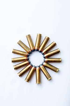 A circle formed by several brass bullets, ammunition for a revolver.