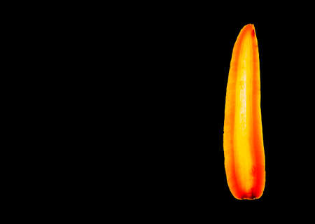 Macro detail of a slice of a carrot on black background.Transparency.Food. 免版税图像