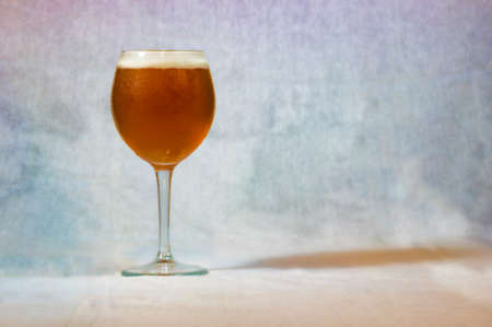A glass with beer on colorful background