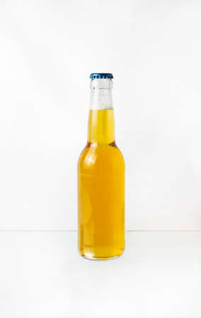 a transparent bottle of beer isolated on white background