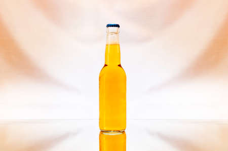 a transparent bottle of beer isolated on colorful background