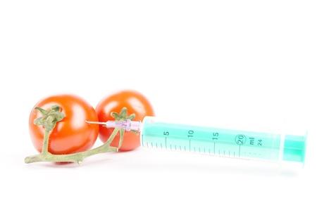 smallpox: tomato and syringe Stock Photo