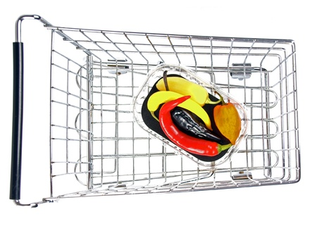 consumerist: shopping cart with chilli peppers Stock Photo