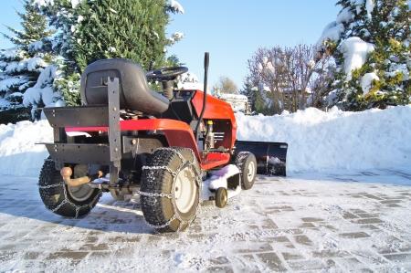 Traktor Winterdienst Standard-Bild