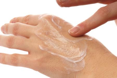 Hand mit Hand Cream Standard-Bild