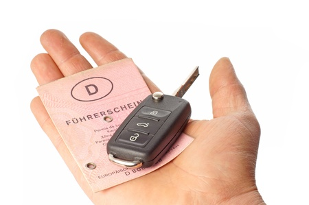 Hand with Car Key and Driver License photo
