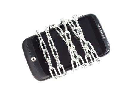 Smartphone with Chain over a white Background photo
