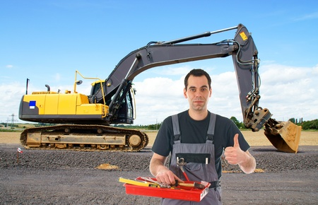 construction worker in front of a excavators photo
