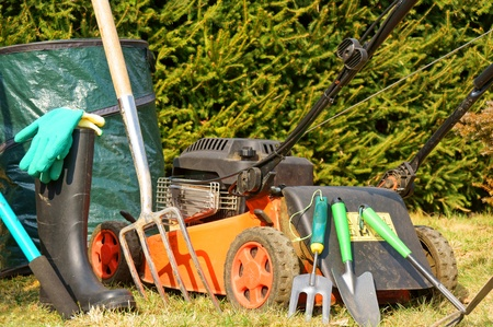 Garden tools and lawn mower Stock Photo - 12841075