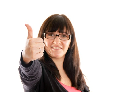 Portrait of a young brunette woman showing thumbs up Stock Photo - 12947651