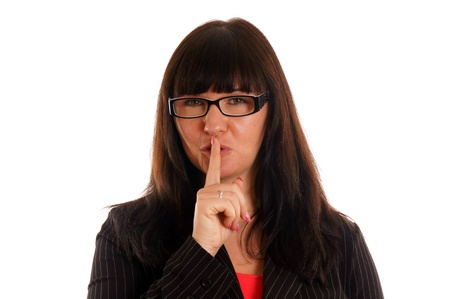 Young woman holding her finger to her mouth Stock Photo - 12960208