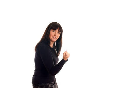 Portrait of a young woman who makes a fist Stock Photo - 12959572