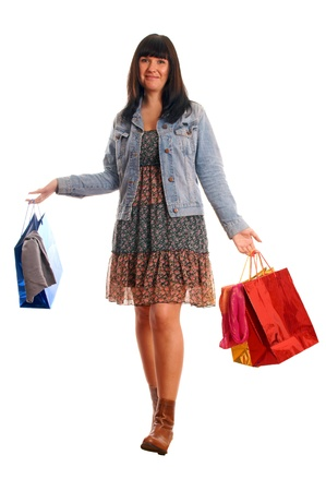 Attractive young girl with shopping bags photo