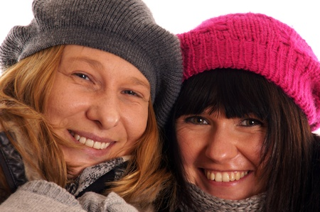 Two young women in winter clothes Stock Photo - 12965682