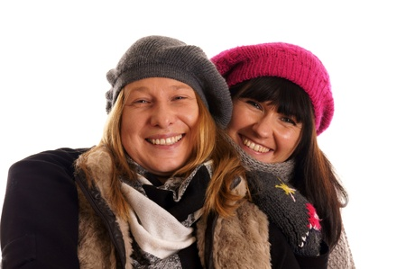 Two young women in winter clothes Stock Photo - 12965669