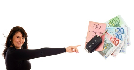 Woman pointing to a car key and notes photo