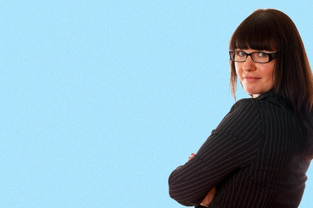 confident young business lady over a blue backgound Stock Photo - 13310718