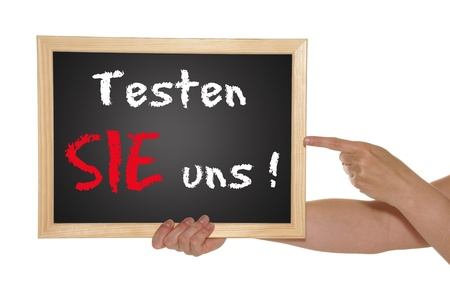 blackboard with the german text Test Us Stock Photo - 13918982