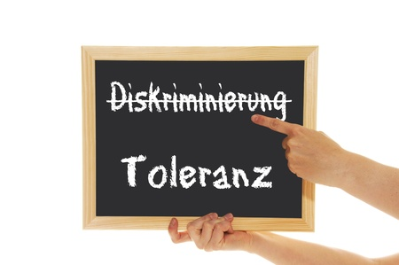 tolerance: blackboard with the words discrimination and tolerance