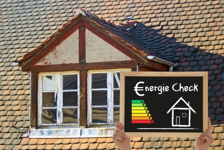 old house and blackboard with Energy Check photo
