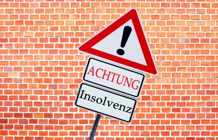 insolvency: sign with the german words insolvency and attention