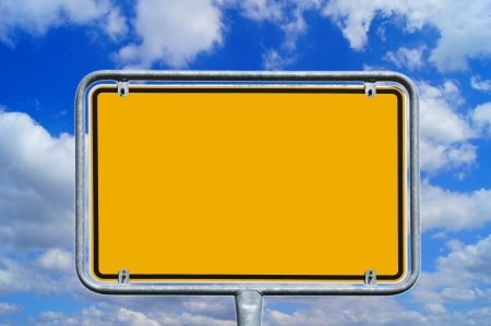 empty sign over a background with blue sky and clouds photo