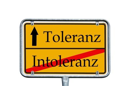 intolerancia: firmar con la tolerancia de las palabras en alem�n y la Intolerancia Foto de archivo