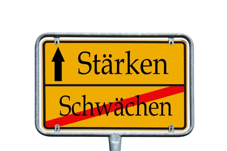 strengthen: street sign with the german words strengthen and weaken