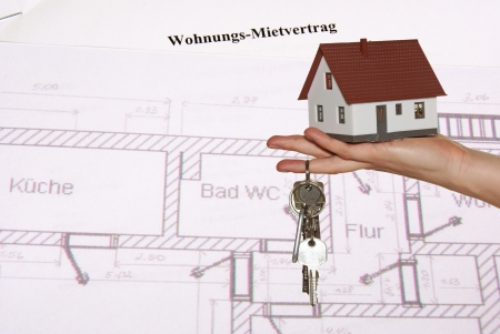 Plan and hand with house Stock Photo